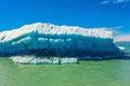 The huge white-blue iceberg floats