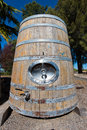 Huge wine storage barrel with handle and spigot Royalty Free Stock Photo