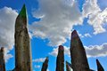 Huge wooden poles in the shape of coloured crayons Royalty Free Stock Photo