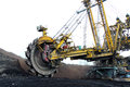 Huge yellow coal excavator in coalmine action Royalty Free Stock Image