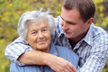 Hugging elderly person Royalty Free Stock Image