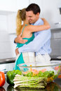 Hugging in kitchen Royalty Free Stock Image