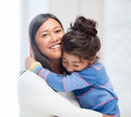 Hugging mother and daughter family children happy people concept Stock Photos