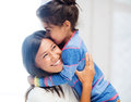 Hugging mother and daughter family children happy people concept Royalty Free Stock Images