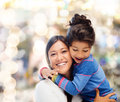 Hugging mother and daughter family children happy people concept Royalty Free Stock Photography
