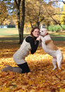 Hugs cute woman walking with dog Royalty Free Stock Photos