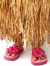 Hula skirt and flip flops Royalty Free Stock Images