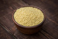 Hulled millet on a dark background Royalty Free Stock Images