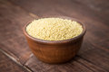 Hulled millet on a dark background Royalty Free Stock Photos