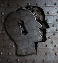 Human brain door with keyhole concept made from metal gears and cogs Royalty Free Stock Images