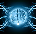 Human brain between thunder lightning Stock Photos