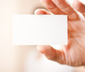 Human hand holding blank business card with copy space small dof Stock Images