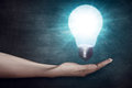 Human hand holding light bulb. Creativity concept Royalty Free Stock Photo