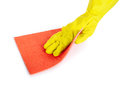 Human hand with rubber glove wiping with a cloth Royalty Free Stock Photo