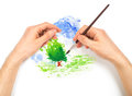 Human hands with brush painting nature landscape on white background Royalty Free Stock Images