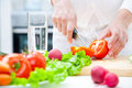Human hands cooking vegetables salad kitchen Royalty Free Stock Images