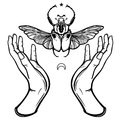 Human hands hold Goliath`s bug. Symbols of the moon. Mysticism, esoterics, sorcery.
