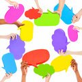 Human hands holding speech bubbles Royalty Free Stock Photo
