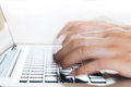 Human Hands typing on laptop in blurred motion with copy space a Royalty Free Stock Photo