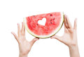 Human hands and water melon isolated on white background Stock Photography