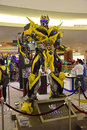 Human size model of bumblebee from transformers with front view full body on display in public mall getting ready for the premier Stock Image