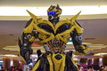 Human size model of bumblebee from transformers with front view half body on display in public mall getting ready for the premier Royalty Free Stock Photo