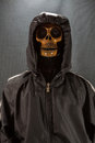 Human skull on a black background. halloween day or Ghost festival, Ghost on suit Royalty Free Stock Photo