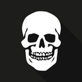 Human skull on a black background with long shadow Royalty Free Stock Photo