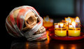 Human skull with candle