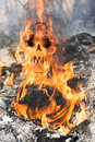 Human skull in fire flames appears meaning death by the accident Stock Image