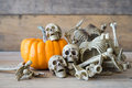 Human skull on wood background ,Skeleton and pumpkin on wood ,Happy Halloween background Royalty Free Stock Photo