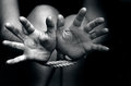 Human trafficking concept photo a missing kidnapped abused hostage victim woman with hands tied up with rope in emotional stress Stock Photos