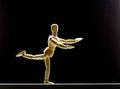 Human wood manikin is dancing on black Royalty Free Stock Image