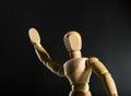 Human wood manikin waving closeup Stock Photos