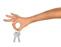 Humans hand with keys on isolated white background Royalty Free Stock Photo