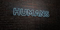 HUMANS -Realistic Neon Sign on Brick Wall background - 3D rendered royalty free stock image