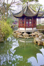 Humble administrator s gardens suzhou china beautiful red pagoda in the unesco site of the Royalty Free Stock Images