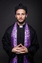 Humble catholic priest studio portrait on black background Royalty Free Stock Photo