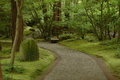 Humid walkway in japanese garden a Royalty Free Stock Photo