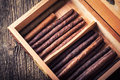 humidor with quality cigar and cognac Royalty Free Stock Photo