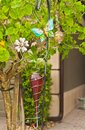 Humming bird feeder  at entrance to tropical residential home Royalty Free Stock Photo