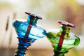 Hummingbird feeders on bokeh background objects Royalty Free Stock Photo