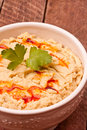 Hummus in a bowl on a wooden background Royalty Free Stock Photo