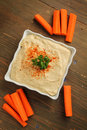 Hummus with carrots Stock Photography