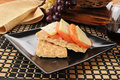 Hummus, cheese and tomato on crackers Royalty Free Stock Photo