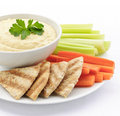 Hummus with pita bread and vegetables Stock Image