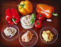 Hummus with red yellow and orange bell peppers ready to dip garlic tomatoes variety of instagram like effect added Royalty Free Stock Image