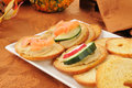 Hummus on sliced bagel toasts Stock Images