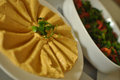 Hummus and tabbouleh with salad in the background Royalty Free Stock Image