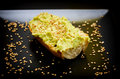 Hummus on toasted bread with sesame seeds Royalty Free Stock Photos